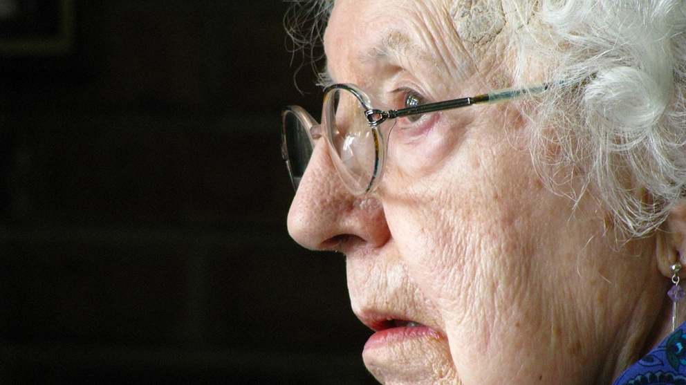 Side view portrait of an elderly woman with glasses